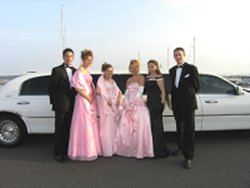 wedding party beside stretched limo