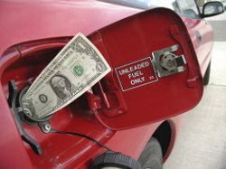a bank note sticking out of a car fuel tank