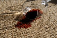 glass of red wine spilled on carpet