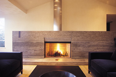 fireplace with concrete surround and hearth