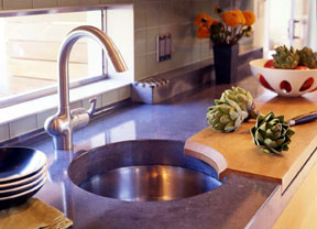 circular sink set in concrete worktop