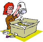 lady packing away items in a cardboard box