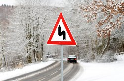 road bends traffic signal in snowy surroundings