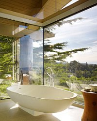 freestanding bath by glass patio doors overlooking view