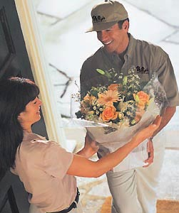 man delivering flowers to lady