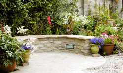 curved garden seating made from stone