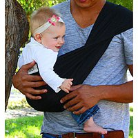 a man carrying baby in sling