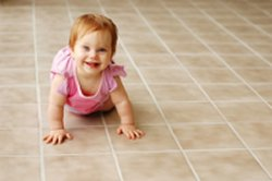 baby crawling on tiled floor