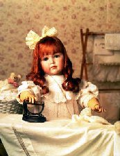 tableau of doll ironing