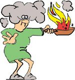 A Lady Holding A Frying Pan Which Is On Fire
