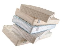 stack of mattresses - Best Time To Buy A Mattress