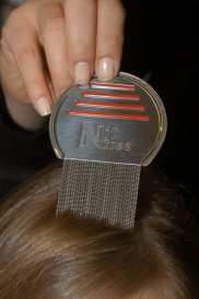 someone using Nitty Gritty NitFree Comb