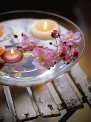floating candles in a shallow glass dish