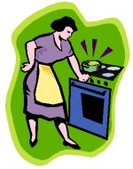 lady in apron in front of oven