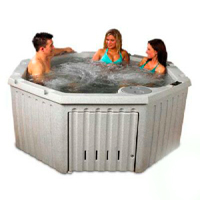 three people in a hot tub