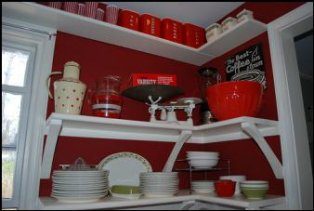kitchen with red walls, kitchen appliances and accessories