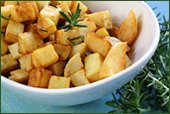 a bowl of cubed potatoes and rosemary