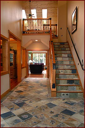 decorative tiling on hall floor and stairs