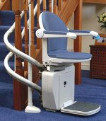 curved stairlift at foot of stairs