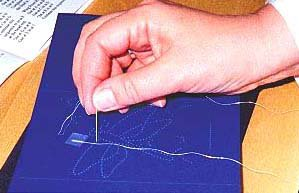 thread attached to back of card