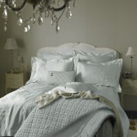 bed with white bed linen