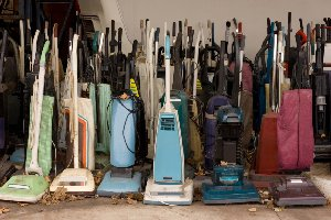 collection of old vacuum cleaners